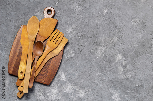 Wooden cutting Board with wooden old cooking spoons Canvas Print
