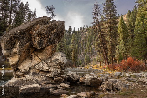 Fotografie, Tablou Landscape image of a mountain stream with large rock formation in the foreground