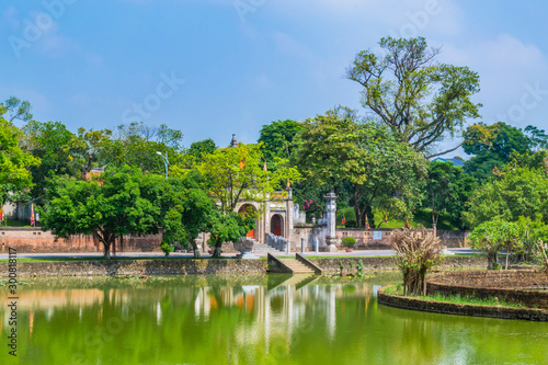 Leinwand Poster  Scenery of Thuong shrine with lake and traditional well in ancient Co Loa citadel, Vietnam