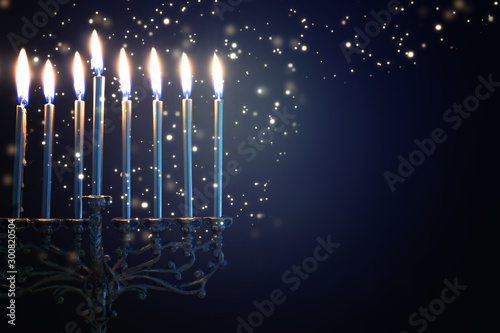 Vászonkép Religion image of jewish holiday Hanukkah background with menorah (traditional c