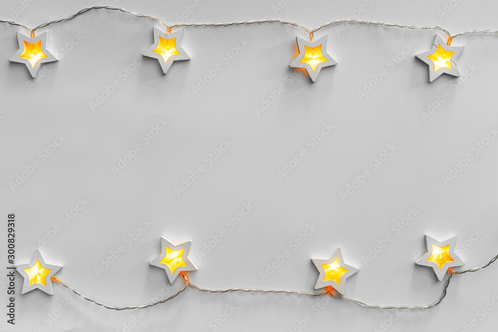 Fototapety, obrazy: Illuminated star shaped garland on light gray background