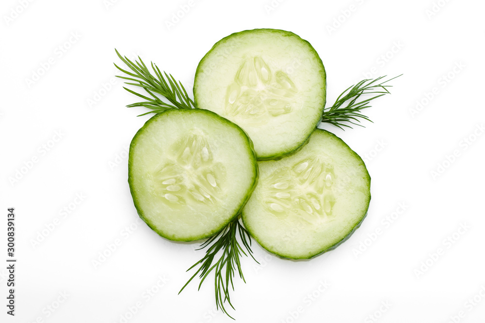 Fototapety, obrazy: fresh cucumber slice with dill, isolated on a white background. top view