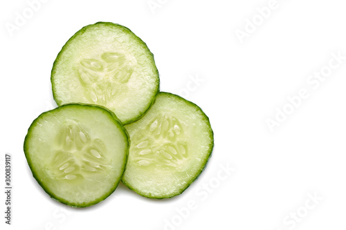 Fotografía  fresh cucumber slice, isolated on a white background. top view