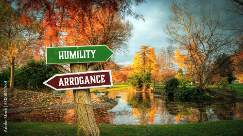 Photo Street Sign to Humility versus Arrogance