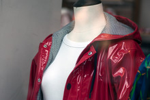 Closeup Of Red Rain Coat On Mannequin In Fashion Store Showroom