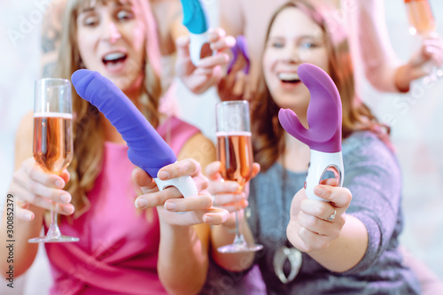Photo Women showing sex toys they bought at a dildo party