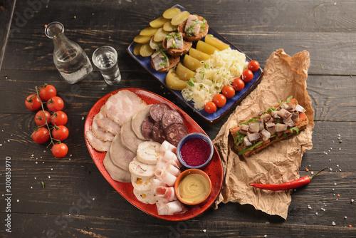 Valokuvatapetti assorted homemade sausages and meat with mustard and horseradish