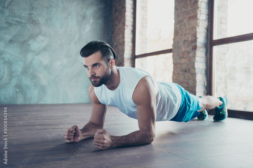 Fototapety, obrazy: Profile photo of macho sportsman guy doing plank on elbows hands leaning floor determined sportswear tank-top shorts sneakers training house studio windows indoors