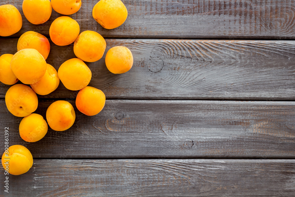 Fototapety, obrazy: Fruit background with apricots on dark wooden background top view copy space