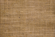 Rough Hessian Background With Flecks Of Varying Colors Of Beige And Brown. With Copy Space. Office Desk Concept, Hessian Sackcloth Burlap Woven Texture Background.