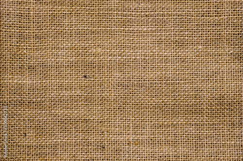 Fotografiet  Rough hessian background with flecks of varying colors of beige and brown