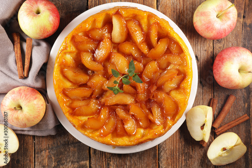 apple pie, tarte tatin with spices on wood background Canvas Print