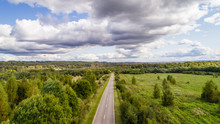 Landscape Aerial View Summer Day. Beautiful Image Bird's-eye Views Of Fields And Forest And Roads And Settlements