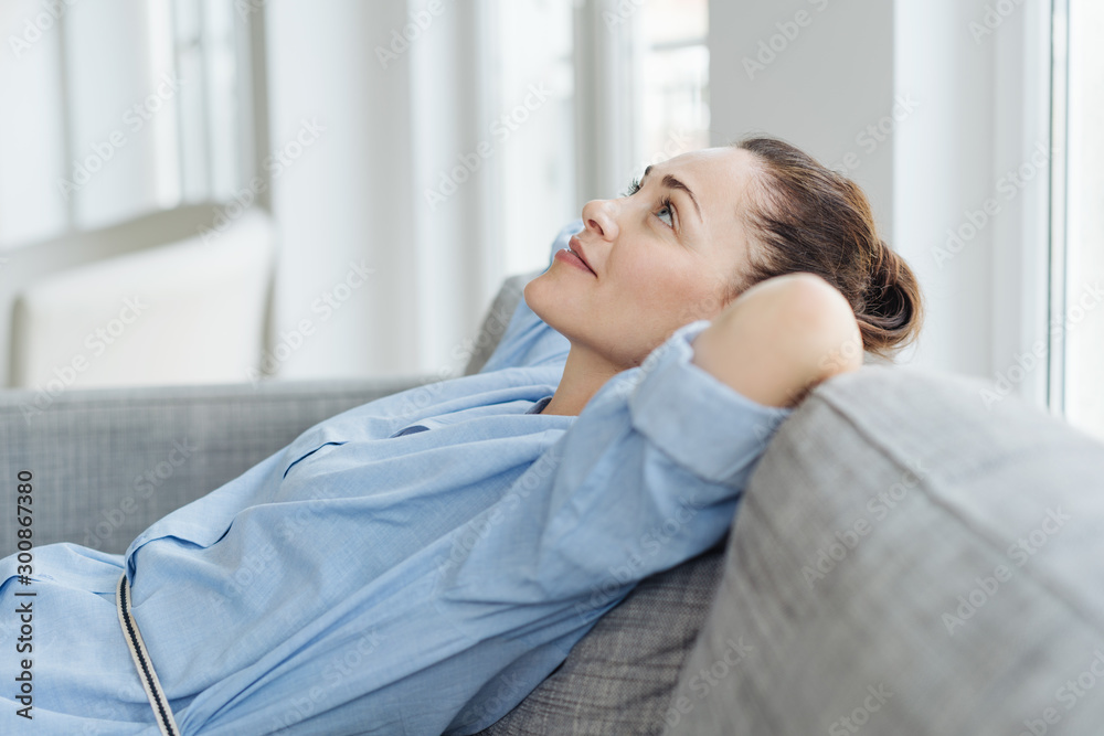 Fototapeta Attractive young woman deep in thought