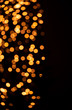 Golden bokeh on a black background. Abstraction
