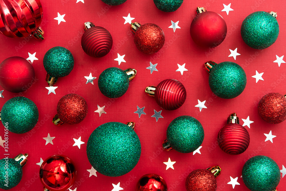 Fototapety, obrazy: Christmas red background with red and green baubles, glitter with copy space. Winter christmas frame border.