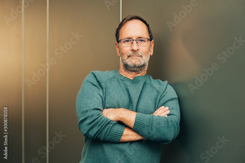 Outdoor portrait of 50 - 55 year old man wearing green pullover and eyeglasses, Fototapet