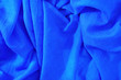 canvas print picture - Crumpled blue fabric. Empty textile background, top view
