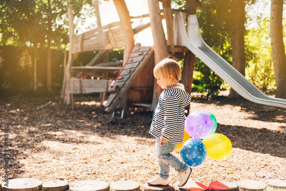 Fototapety, obrazy: Funny kid girl playing with colorful balloons on playground
