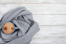 Cup Of Spicy Coffee Wrapped In Grey Wool Scarf Or Plaid. Autumn Or Winter Drink Concept, Latte, Cappuccino, October, November, Anise