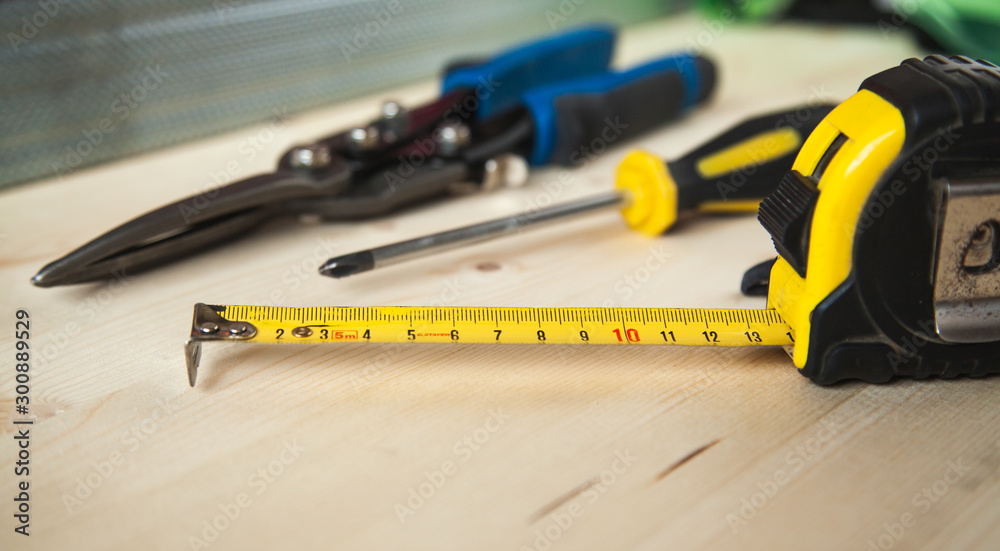 Fototapety, obrazy: Building tool kit on the wood table. Roulette, screwdriver, metal scissors