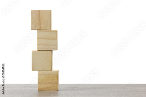 stack of wooden block on wood table against white background. Wallpaper Mural