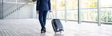 Panoramic Shot Of Businessman In Formal Wear Holding Suitcase