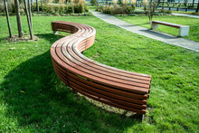 A Modern Bench  In A City Park...