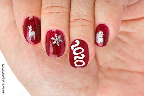Finger nail with christmas pattern Fototapet