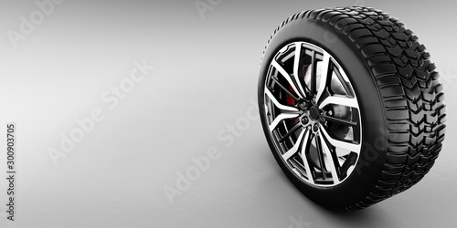 Wheel with modern alu rim on white background
