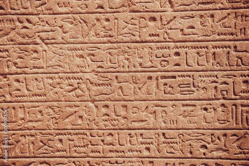 old egypt hieroglyphs carved on the stone Fototapet