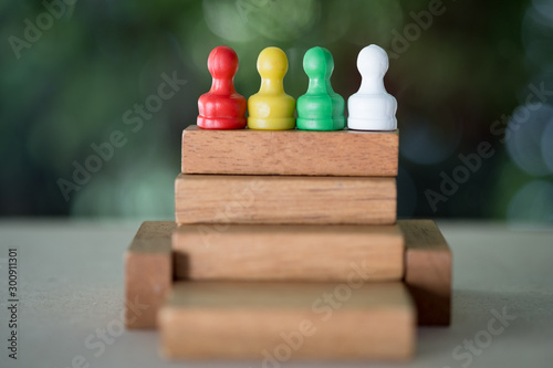 Chess pawn on a toy wooden ladder. Concept to symbolize achievement