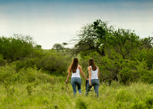 Young Female Sisters Walk In T...