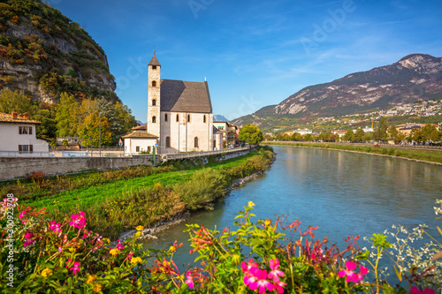 Obraz Beautiful scenery of Trento city with Saint Apollinare church at Adige river, Northern Italy - fototapety do salonu