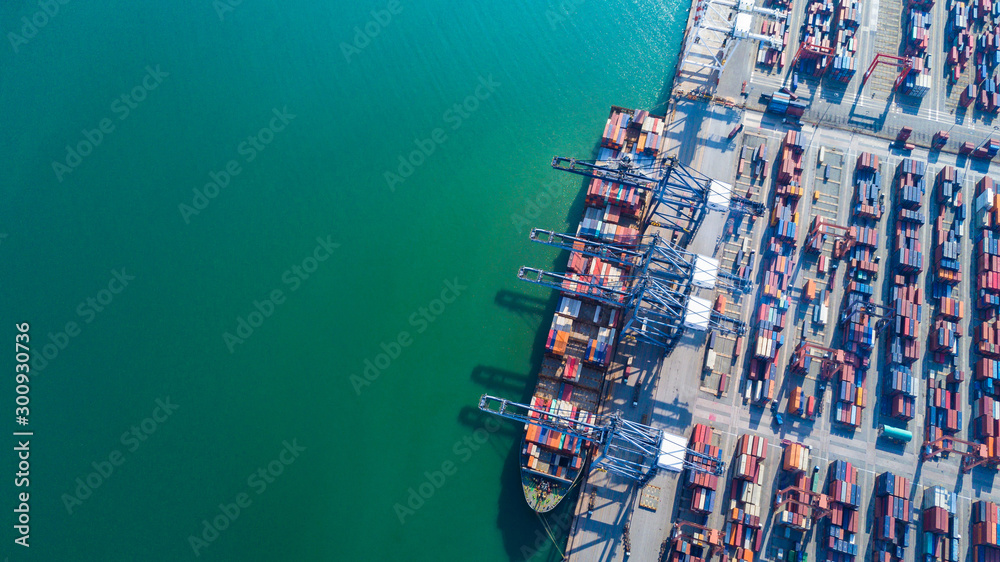 Fototapety, obrazy: Container ship at industrial port in import export business logistic and transportation of international by container ship in the open sea.