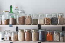 Shelves With Glass Jars Filled With Groceries