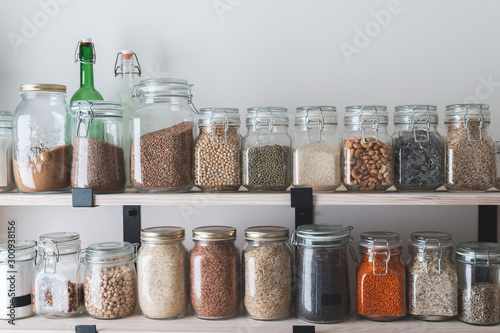 shelves with glass jars filled with groceries Tableau sur Toile