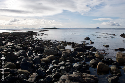 Fotografiet Isle of Arran Shoreline with Alisa Craig on horizon