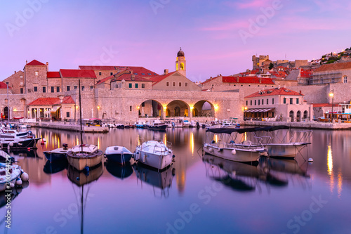 Foto auf Gartenposter Flieder Old Harbour and Old Town of Dubrovnik at sunset, Croatia