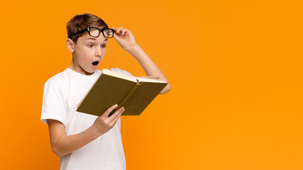 Emotional teenager reading bestseller science fiction book