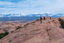 Son, Mother And Grandfather Riding Mountain Bikes Of Singletrack In Moab, Utah
