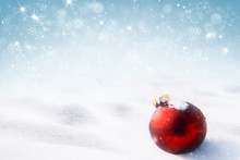 Red Christmas Ball On Snow With Snowflakes