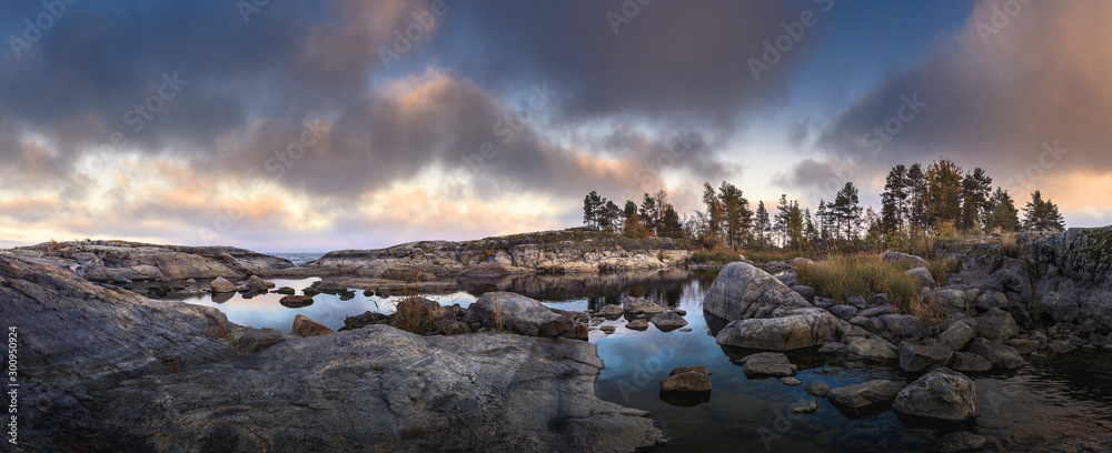 Fototapety, obrazy: Moody sunset over northern shore with dramatic sky. Scandinavian scenic view