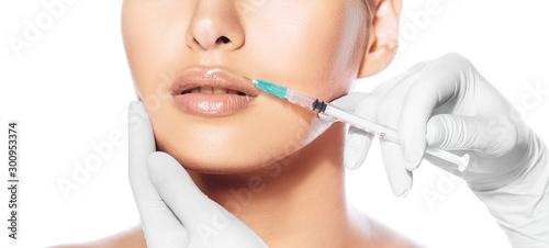 Fotografía Cropped female face during lip augmentation procedure