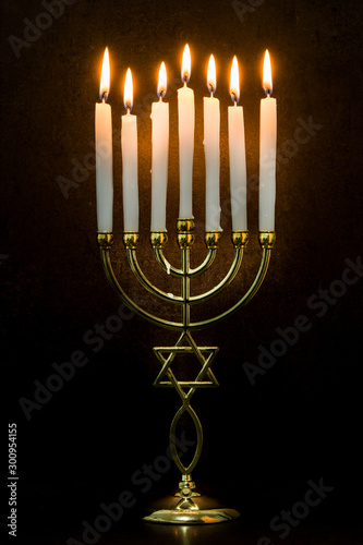 Obraz na plátně Jewish Hanukkah menorah on black background.