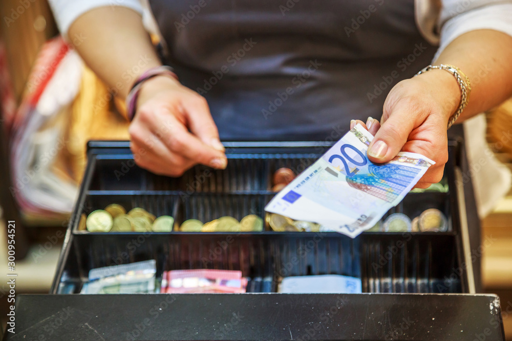 Fototapety, obrazy: woman is paying In cash with euro banknotes