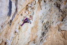 Female Climber On Challenging ...