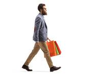 Bearded Man Walking And Carryi...