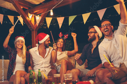 Friends at New Years Eve party Canvas Print