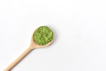 Wooden Spoon With Powdered Matcha Green Tea In Bowl Isolated On White Background.